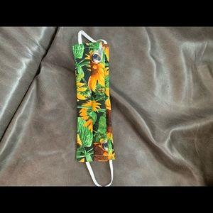Sunflowers on green background pocket mask